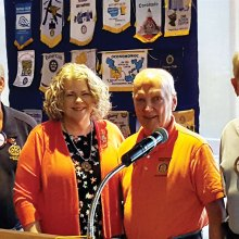 President Joe Guyton, Joe McGowan and Jim Lamb welcome Wendy Guyton to SaddleBrooke Rotary.