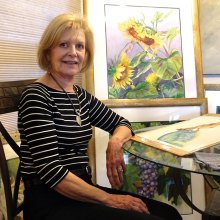 Renee Pearson pauses with a few of her watercolors.