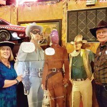 Sharon and Garrett Ressing pose with the Lone Ranger, Tonto and John Wayne.