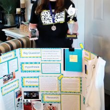 Elena Hendrix with her project board and all her awards