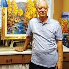 Mick Desmarais displays his first-place oil painting Sabino Canyon Autumn Splendor.