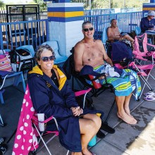 Jeanie and Mike Polak relaxing after competing in the State LC Championship Meet; photo by Rodger Bivens.