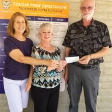 Marcia Schima and Mark Erickson present check to Darlene Cavanaugh (Oracle's Mountain Vista K-8 school librarian).