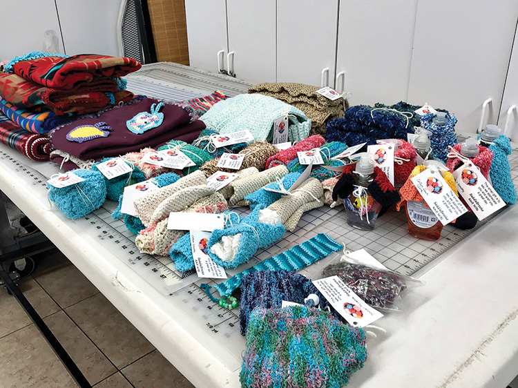 Just look at the collection of items donated to Senior Village. Thanks, knitters!