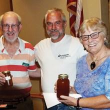 Don Grafmiller and Darlene Carlson won honey from speaker Steven Thoenes.