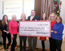 Check to UA Cancer Center. Left to right: Liz Benzie, Ironwood Dermatology, tournament sponsor; Sharon Marchione, MPWGA; Julie Bauman, Director UA Cancer Center; Chad Adams, Associate Director of Clinical Research, UA; Megan Guthrie, UA Cancer Center; Amy Marchione, Sparkle & Splash, Caddy Auction Sponsor; Betty Cole, MPWGA; Photo by Andrea Gray.