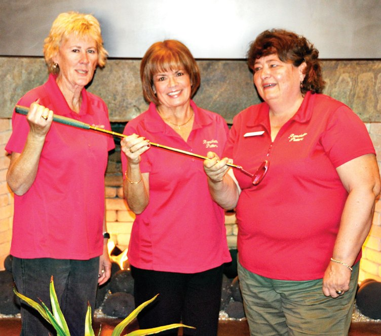 Passing of Putter: past Co-Presidents Linda Bowman and Janice Neal on left, pass the Putter to new President, Linda Shannon-Hills. Photo by Bob Hills undefined