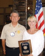 Rotary Club of SaddleBooke President Jim Lamb awards Linda Turbyfill with the Rotarian of the Year honor.