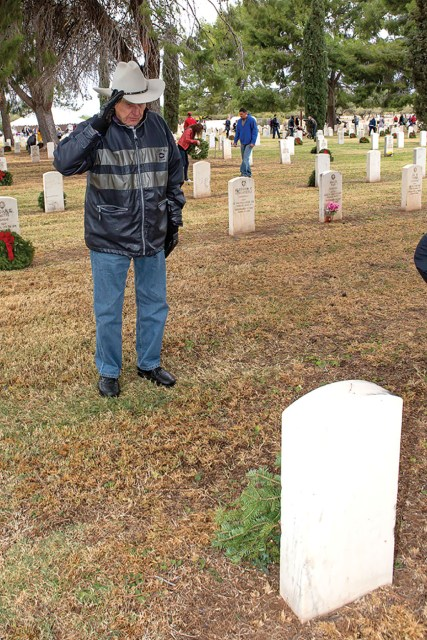 Cliff Terry of SaddleBrooke Ranch saluting a veteran's grave
