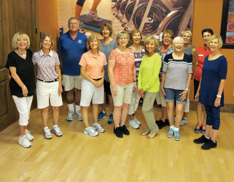 Level 2 line dance class takes a photo break in the Hacienda aerobics room. They just perfected 'Smoky Places,' their newest dance-a rumba. 'Cowboy Rhythm' will follow this break and pump up their heart rates.