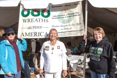 While actively promoting Wreaths Across America in Tucson, Linda Nicholson (right) participates in the annual ceremony at Evergreen Cemetery, where volunteers remember and honor our veterans. Photo includes Kay Lantow (left) and Sheron Jones (center), an American Gold Star Mother.