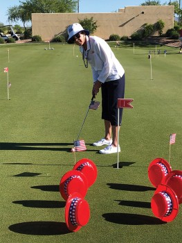 Putting with patriotic obstacles.