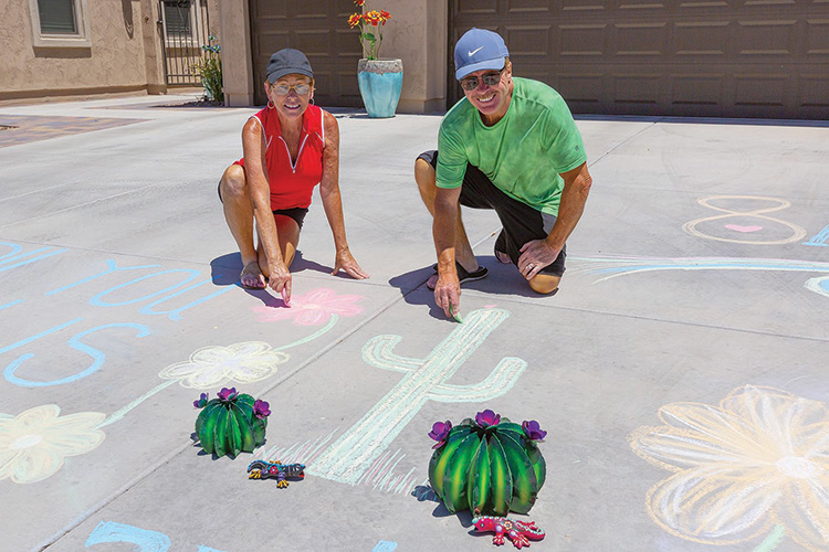 Larry and Teresa Burchfield's original poem and accompanying illustrations won the Most Creative award in Unit 8A's 50th Happy Hour driveway display contest. (Photo by Steve Weiss)