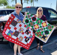 CJ Kerley from the SaddleBrooke Ranch Piecemakers (left) presenting quilts and household items to Meagan MacCleary with La Casa De Paz.