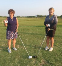 State Medallion winners Lee Rinke (low net) and Jean Cheszek (low gross) with their new State Medallion ball markers.