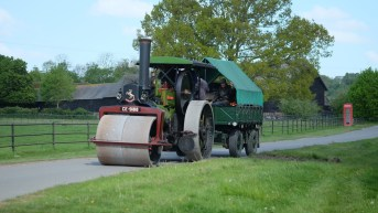 Steam roller coming down the hill past Home farm