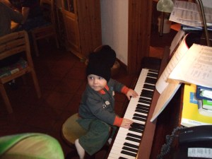 Isaiah taking a turn at the piano.