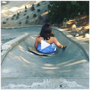 This cement slide is too rough to go down without cardboard to reduce friction.