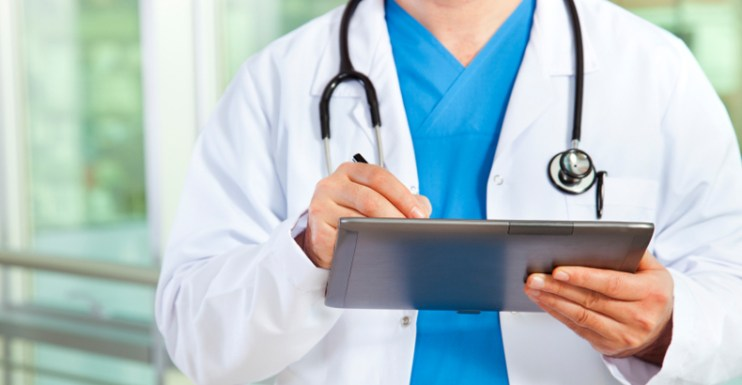 doctor entering information on tablet