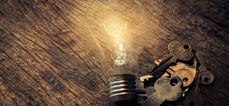 light bulb and keys on table
