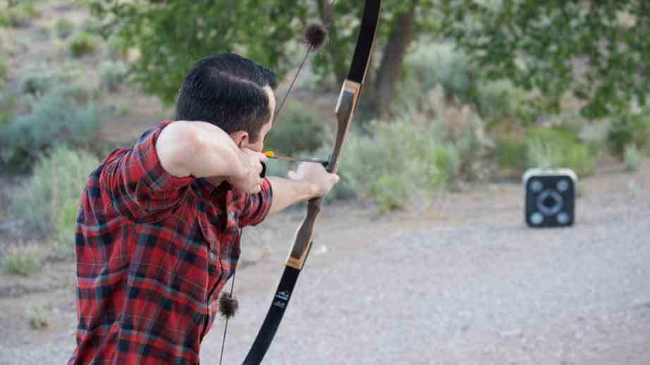 Striking the arm with the bow string