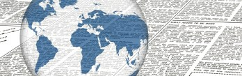 Globe superimposed over newsprint