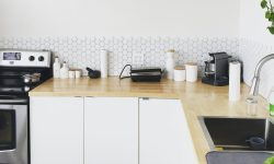 tidy counter with black coffee maker on brown wooden kitchen table