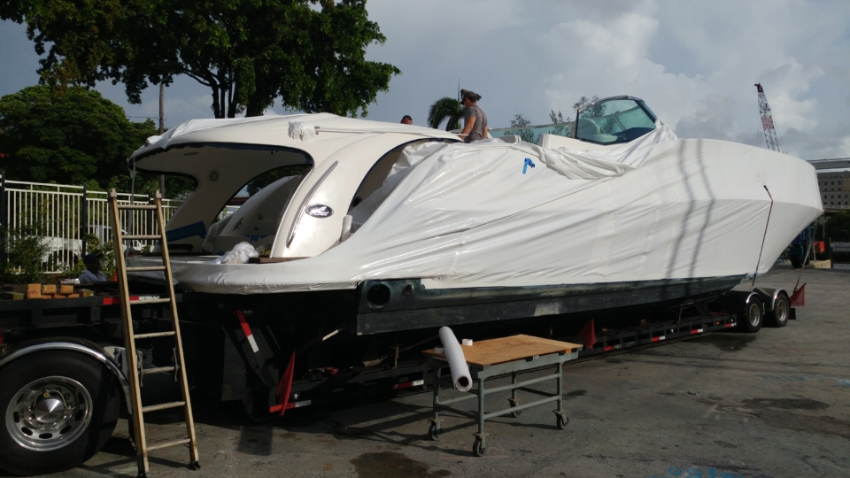The Sundancer in progress of having the shrink wrap put onto the boat. Front of the boat is completed, back still in progress.