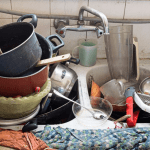 Keep bugs out of your house: dirty dishes piled in sink