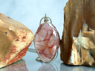 Red quartz pendant, transparent silver set crystal