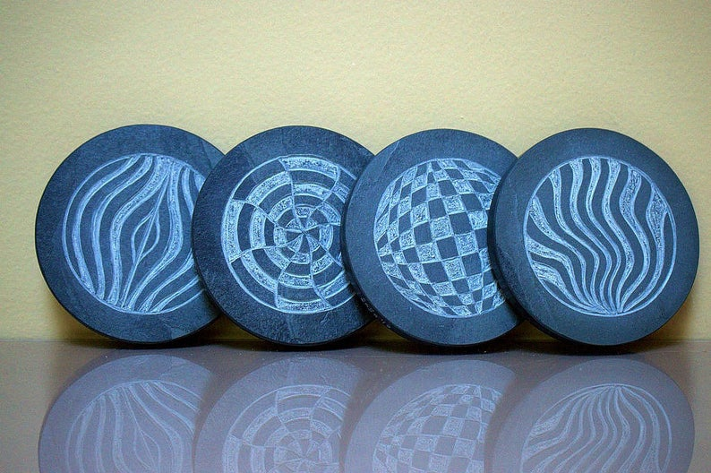 Black stone coasters hand carved Op art design