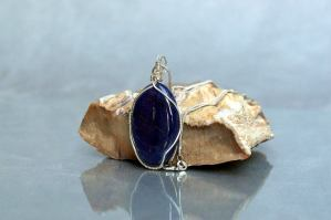 shiny blue stone stands with petrified wood
