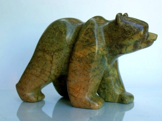 Brown green walking bear stone carving