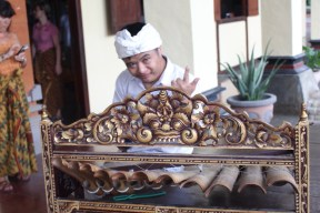 Down Syndrome boy playing the gamelan for guests at Taman Gili