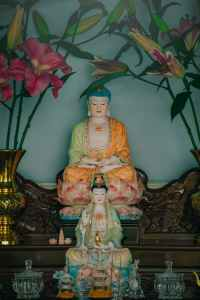 two buddha figurines