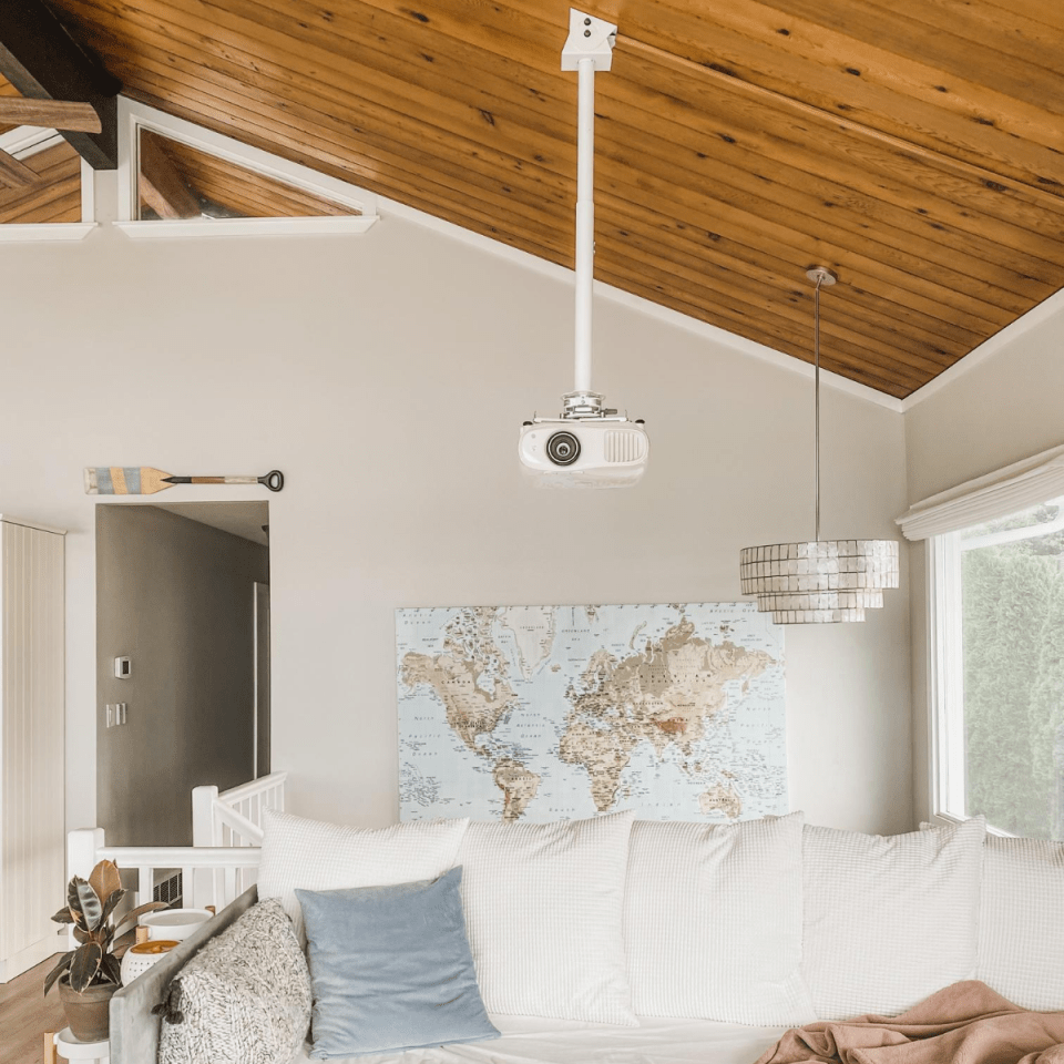 4K Projector on high vaulted angled wood ceiling