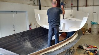 Hull liner being fitted into place.