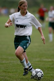 Young Amanda playing college soccer