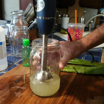 Mixing the aloe gel and isopropyl alcohol