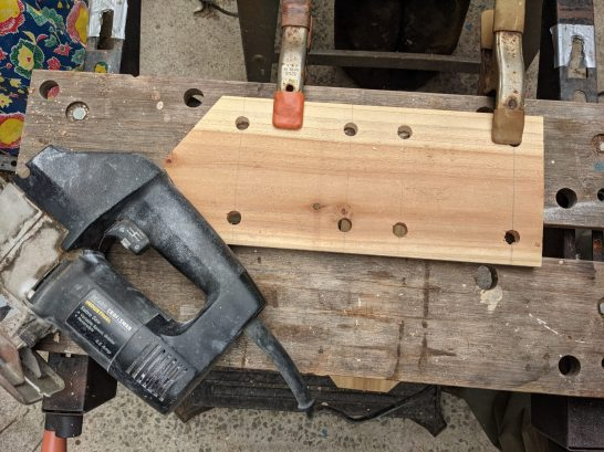 Drilling the holes in the front for the slots