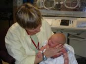 Midwife and baby in hospital