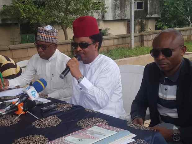 Senator Shehu Sani ( middle)  addressing journalists at the programme in Abuja
