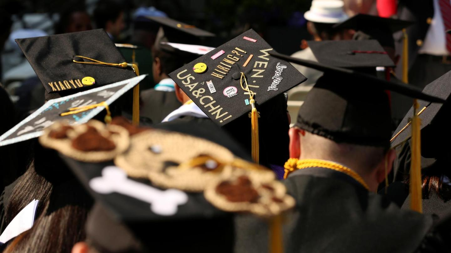 """An adorned graduation cap saying, """"USA and CHN"""" at The City College of New York commencement ceremony in Manhattan on May 31, 2019."""