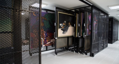 This is the new racking system we installed to store the Museum's permanent collection. Housed in a spacious storage room beneath the Museum, the collection is kept in climate-controlled conditions optimal for its preservation. Photograph: Nabû Productions/The Sursock Museum. via The Guardian