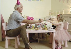 A still of a grandfather enjoying tea with his granddaughter from the National Ad campaign 2016