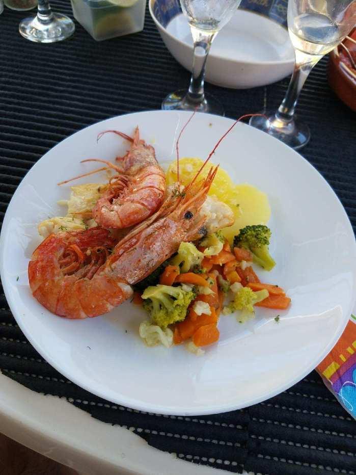 Mallorca catamaran day trip food prawns