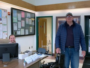 Employee sitting at desk at Southern Adirondack Independent Living Center
