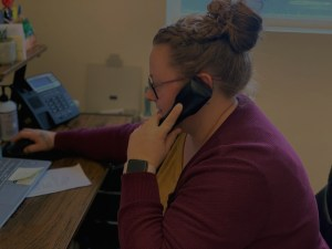 Employee on a phone call while sitting at a desk