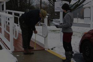 SAIL employees taking measurement of an outside ramp