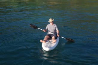 Mac trying out the SUP as a kayak